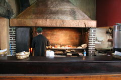 Open aire grill in Antigua Guatemala Restaurant. A chef prepares lunch over a huge charcoal grill in a restaurant in Antigua Guatemala Stock Photography