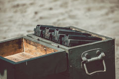 Open ammunition box. On the ground with machine gun case Royalty Free Stock Photography