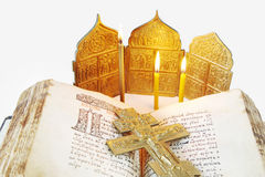 Open ancient Bible and metal crucifixion Royalty Free Stock Images