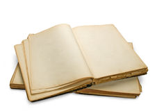 Open ancient book with blank pages. Open ancient book with blank pages, isolated on white background Royalty Free Stock Photo