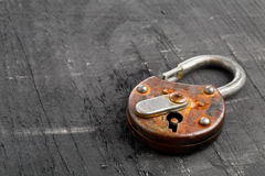 Open antique padlock on black Royalty Free Stock Photos