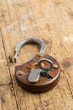 Open antique padlock with key in lock Stock Images