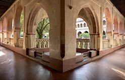 Open arcade gallery of Mudejar cloister of Guadalupe Monastery. Caceres, Extremadura, Spain. HDR Stock Photography