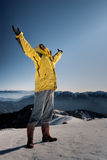 Open arms. Man with open arms against blue sky on white snow hill Stock Images