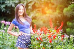 Open arms asian little girl in beautiful flower spring meadow. Beautiful Asian girl is smiling in purple flower field, Chiang Mai,Thailand royalty free stock photo