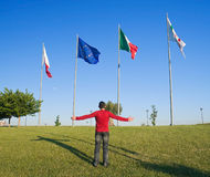 Open arms and flags. Royalty Free Stock Images