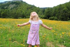 Open arms girl in beautiful flower spring meadow Stock Photos