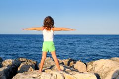 Open arms girl looking blue ocean sea feel freedom Royalty Free Stock Photography
