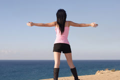 Open arms girl at seaside. Nice girl at seaside standing open arms stock photography