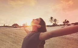 Open arms girl at sunset caribbean beach. In Mexico Stock Photography