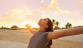 Open arms girl at sunset caribbean beach. In Mexico Stock Photos