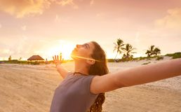 Open arms girl at sunset caribbean beach. In Mexico royalty free stock photography