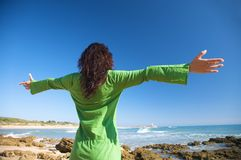 Open arms green dress woman Stock Image