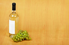 Open arrangement of bottle of white wine Royalty Free Stock Photo