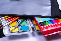 Open bag with colorful items for the school start Stock Image