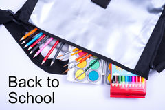 Open bag with colorful items for the school start Royalty Free Stock Photos
