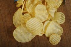 Open bag with potato chips stock photos