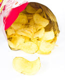 Open bag with potato chips on white background Royalty Free Stock Photo