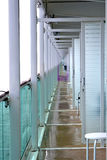 Open Balconies on a Cruise Ship. While at port and most of the passengers were gone the crew took the opportunity to clean the balconies. To do this all the Royalty Free Stock Image
