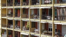 Open balconies littered with stuff, hostel in tropical country, room for rent. Stock photo stock images