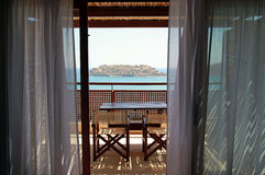 Open balcony with furniture and sea view(Greece) Royalty Free Stock Images