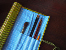 Open bamboo case with paint brushes for the artist Stock Images