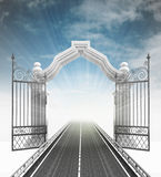 Open baroque gate with highway and sky Stock Image
