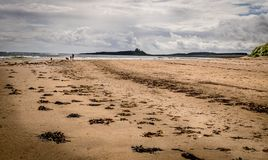 An open beach with silhouette of a family and a castle. stock photo