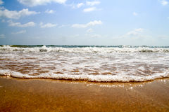 Open beach with waves breaking Stock Photos