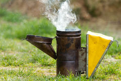 Open bee smoker Stock Images