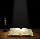 Open Bible. On a table with a candle with copy space above Royalty Free Stock Images