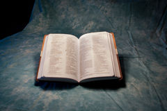 Open Bible. An open Bible sitting on a blue background royalty free stock image