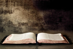 Open Bible. With textured granite background Stock Images