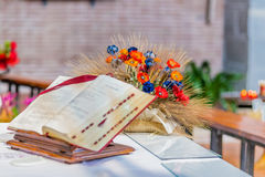 open Bible on the altar of Catholic Church Stock Image
