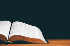 Open bible. On black background Stock Photo