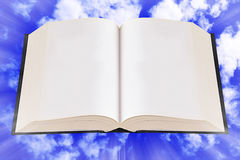 Open Bible, Book on The Sky. Open bible, book on blue sky background, blank page Stock Image