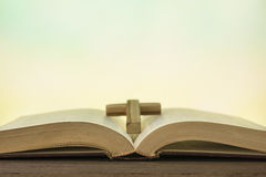 Open bible book on wood table stock photography