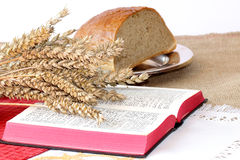 Open Bible and bread Royalty Free Stock Photography
