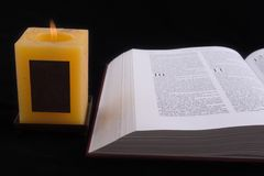 Open Bible and Candle Stock Photo
