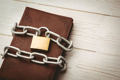 Open bible chained with lock Stock Image