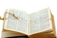 Open bible with cross. Old open Bible with cross Royalty Free Stock Photos
