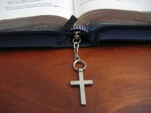Open bible with cross. An open bible with a small cross Royalty Free Stock Image