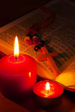 Open Bible with cross and burning candles Royalty Free Stock Image