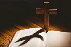 Open bible with crucifix icon behind Royalty Free Stock Images