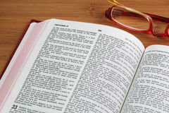 Open Bible with glasses Royalty Free Stock Photos