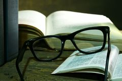 Open Bible with Glasses Royalty Free Stock Photo