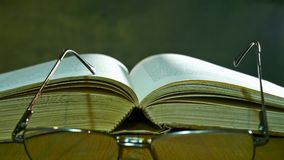 Open Bible with Glasses Stock Image
