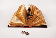 Open Bible with key Stock Photography