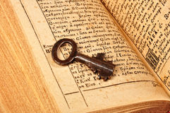 Open Bible with key Stock Photos