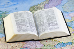 Open Bible on the map Royalty Free Stock Photo